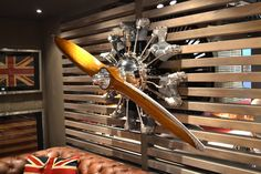 front of a plane wall sculpture Deco Aviation, Aviation Theme, Garage Furniture, Cool Furniture, Furniture Design, Aviation Furniture, Airplane Decor, Interior Styling, Interior Design