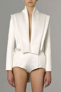 Layers and Lines - modern silhouettes; white tailored jacket & shorts