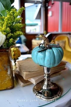 painted pumpkin + twine stem...doing this project right now with Dollar Store foam pumpkins {robin's egg blue, gold and copper}