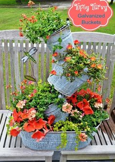 Flowerarrangement in zink buckets...did the pots now I gitta try this one