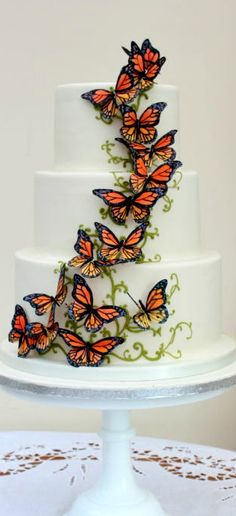 The adventurers' cake – This is a wedding cake I made for a couple who had travelled the world living together on three continents and had chosen the iconic migrating monarch butterflies as their wedding theme symbolizing this. Pretty Cakes, Cute Cakes, Beautiful Cakes, Amazing Cakes, Butterfly Wedding Cake, Butterfly Cakes, Monarch Butterfly, Unique Cakes, Creative Cakes