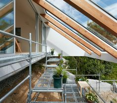 tomohiro hata's hillside house interior integrates terraced platforms