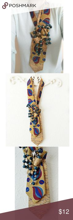 Up-Cycled Neck Tie Necklace An Original by Simply Lena's ~ One of a kind piece ~ Adorable Fish ~ Golds, Blues, Maroon ~ Embellished with vintage jewelry ~ Just slip over head ~ Such a fun conversational piece ~ Dare to be different!! Simply Lena's Jewelry Necklaces