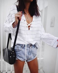 striped white and gray lace up shirt jean shorts black purse necklace straight short brown hair legs hands red nail polish bracelets