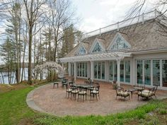 The Academy Award-winning director's rambling 33-acre Greenwich, Conn., estate features a back patio with a view of the 140-acre lake.
