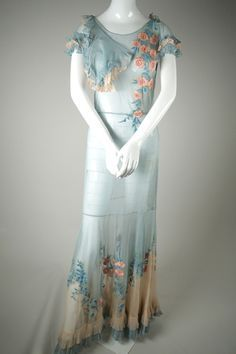 Impeccable couture-quality, two-toned silk tulle gown with floral embroidery and ruffled hem. Amazing representation of a 1930s silhouette in impeccable condition. Sheer, will need to be worn with a s