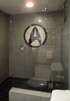 That's right, a Starfleet academy mosaic.  The ENTIRE home was redone in a Star Trek theme....too DARNED cool and this here girl wants to do something like this in her home!