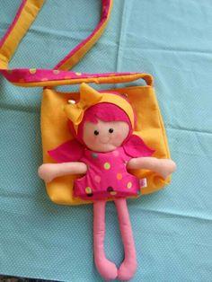 Boneca com bolsa