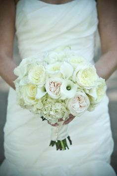 Bouquet of mini white calla lilies, white hydrangeas, and white English garden roses by Bloomin Buckets | Photograph by Stephen Seebeck Photography | Wedding Planner: Cosmopolitan Events