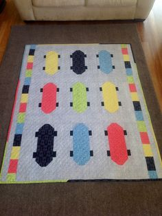 I based it on the kickflip pattern from the may/June 2012 issue of quiltmaker magazine. Just less skateboards. Man Quilt, Boy Quilts, Sports Quilts, Winter Quilts, Skate Board, Doll Quilt, Paper Piecing, Quilt Making, Quilting Projects