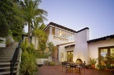 """Williams was a great believer that the mild Southern California climate should be taken advantage of whenever possible. He created an """"outdoor living room"""" on the patio of this home, with a fireplace and furniture that would encourage alfresco meals. The large patio doors also help diminish the demarcation between outdoors and indoors."""