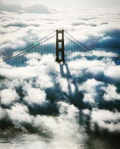 The Golden Gate Bridge peaks through clouds and fog. San Francisco. : @lucsteven #itsamazingoutthere