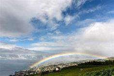 A rainbow appears over Lutry, Switzerland, and Lake Geneva, as seen from the Lavaux Vineyard, Sept.  The Lavaux Vineyard Terraces are on UNESCO's list of world cultural heritage sites.