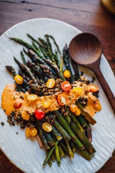 Get the recipe for roasted asparagus with romesco sauce -- an easy vegan weeknight dinner served with blue lentils and cherry tomatoes!
