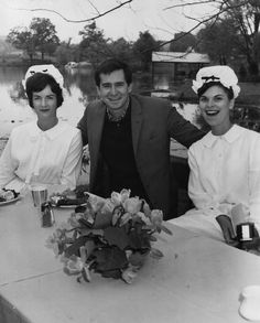 'The Fool Killer' star Anthony Perkins is flanked by Blount County Chamber of Commerce representatives Mrs. Kenneth Yunger, left, and Mrs. William Stroud during a picnic lunch on April 28, 1965, in Louisville. The world premiere of the movie, filmed here in the spring and summer of 1963, was that night at the Tennessee Theatre.