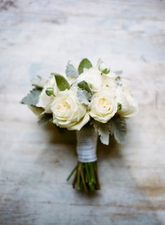 simple and classic rose bouquet with dusty miller - kind of what the bridesmaids bouquets might look like