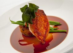 A definite favorite - Pan Seared Chicken Breast with Spiced Pumpkin and Bacon Bread Pudding, Haricot Vert and Bourbon Jus.  By Blue Plate Catering in Chicago