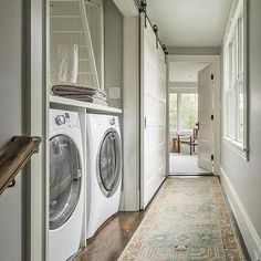Hallway Laundry Room with Sliding Barn Door on Rails