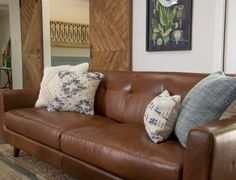 The double barn doors bring texture to the living room and warm up the space.
