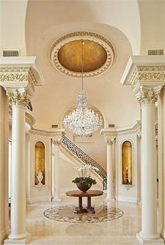 Exquisite foyer is enhanced with faux gilding,dramatic crystal chandelier,elaborate dome ceiling. Soaring 20 foot ceiling,Corinthian columns,vaulted arches with faux bronze dore decoration. Marble inlay imported from Iran is the centerpiece of room. Villa Interior, Luxury Interior, Interior Architecture, Interior And Exterior, Interior Columns, Classic Decor, Classic Interior, Foyer Decorating, Interior Decorating