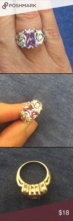 Amethyst ring Premier jewelry ring size 5.  Great quality costume piece.  Purple stone in middle and 3 clear stones on each side. Perfect condition. Premier Designs Jewelry Rings