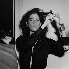 Young Patti Smith, by friend and housemate Robert Mapplethorpe, with a cat who was probably also a badass.