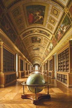 A Day at Château de Fontainebleau library: A highlight from Napoléon III's reign was the transformation of the Diana Gallery, which had become a banquet hall under Louis-Philippe into this spectacular library with large terrestrial globe.