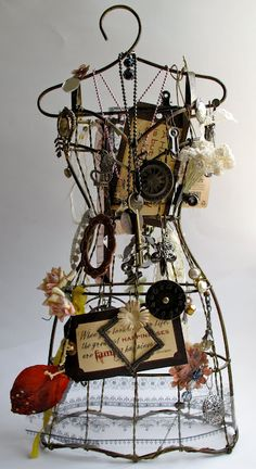 this is so cool. Small wire dress form covered with loveliness.