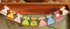 Adorable Paper Dress Garland --for decorating, for playing with the granddaughter, or for scrapbooking!