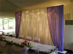 would like to do something like this behind the head table at our reception, just have it all-white instead.