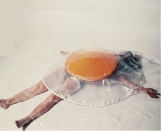 Carole Itter - Raw Egg Costume (1974) Ok - this would be really easy to make, some clear painting tarp and an iron, and some food coloring.  I mean, if you really want to be an egg for Halloween -
