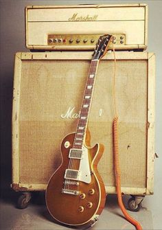 Gibson Les Paul Gold and Marshall *idea-have amps too!! Or incorporate strings as well