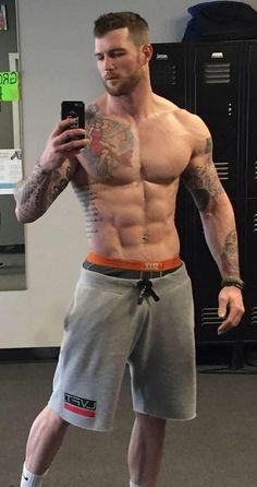 Selfie of beautiful hunk with tattoos
