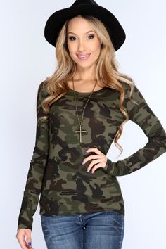Get the style that everyone loves when you add this trendy camouflage top to your collection. With its sexy military print, its sure to compliment any ensemble you pair it with. This style features a camouflage print, long sleeve, scoop neckline, and finished with a comfortable fit. 95% cotton 5% spandex.