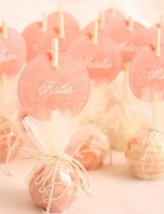 love this idea for seating arrangements or just so everyone knows they received a favor !!!