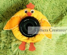 Camera Creatures Chick with Squeaker--stuffed animal that you put on your camera lens. Would make a great gift for a photographer friend! $17