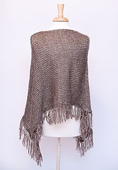 "Homecoming Trunk Shows - This gorgeous poncho material is soft, the edges are fringed and little sequins glitter with movement.  Perfect for those outdoor soccer games or nights on the town, this one size fits most item also comes in gold.   - Approx 17"" (shortest point from opening); 30"" (longest point from opening)  - 100% acrylic  - Dry clean only  - Imported $49.00 www.cwickline.shophts.com"
