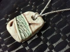 Between the Lines Handcrafted Polymer Clay Pendant with Acrylic Wash. $16.00, via Etsy.