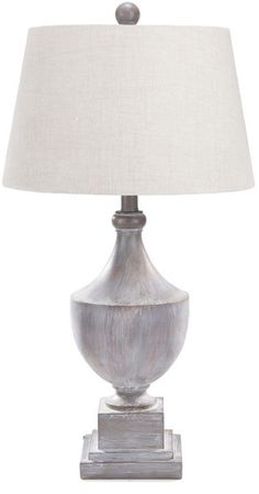 The weathered details of this lamp are what make it so unique to me. It'd be the perfect piece for any beach home!