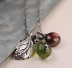 Green vesuvianite brown pearl and silver leaf charm by revelling, $60.00