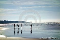 A high contrast image of a strongly back lit family standing on the wet shores of France leaving a strong silhouette of the figures and reflection in the tide on the wet sand. Silhouette Family, Beach Editorial, High Contrast Images, Reflection, Strong, Ocean, France, Water, Painting