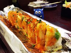 Set your dinner on fire with Flaming Dragon Sushi from Harumi Sushi in San Jose, Bay Are California. Now this is an impressive presentation, the roll is not just hot, but served wrapped in foil and set on fire. For such a low price they give you so much and serve it on fire, this deserve 6 NOMs!