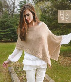 Etched Rio Wrap from Blue Sky: With a wonderful swing and fluidity, this breathtaking wrap will easily become your favorite fall accessory. A simple lace panel makes the Etched Rio Wrap intriguing to knit and effortless to wear! Finished measurements: 32 by 17.75 inches wide. You will need 6 skeins of Blue Sky Metalico and US #3 (3.25 mm) straight needles (or size needed to obtain gauge).  Shown in the color Gold Dust. $8.75