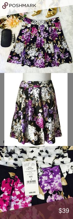 """WHBM Purple/Black Floral Full Skirt Such a beautifu hand-designed floral splashed with Iris, lilac and berry pink colors, subdued by a black background and quiet neutrals. Perfect for a box-pleated skirt sateen cotton. Lightwiegh, soft thread-tacked lining, Hook-and-eye clousure. Shell: 97"""" cotton, 3% spandex. Lining: 100% Polyester. Laid flat across @ waist: 14.5"""", Lenght: 20"""". NWOT White House Black Market Skirts A-Line or Full"""