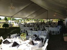 Clearspan Frame Tent with tables, chairs, linens and lighting