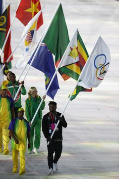 Flag bearer Popole Misenga of the Refugee Olympic Team parades in the 'Heroes of the Games' segment during the Closing Ceremony on Day 16 of the Rio 2016 Olympic Games at Maracana Stadium on August 21, 2016 in Rio de Janeiro, Brazil.