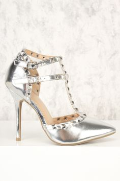 `Style these cuties for all type of looks to be shining all night long. Features include, a metallic faux leather, pointy toe, studded t-strap accent, double buckle closure, and a cushioned foot bed. Approximately a 4 1/2 inch heel.