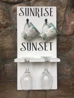 Coffee and Wine rack!! A fun way to display your coffee mugs and wine glasses. Wake up and grab a cup for coffee, and as the sunsets its time for a glass of wine. The measurements are 11x 24 They have 2 sawtooth hangers or a wire on back for easy hanging. Perfect gift for your coffee