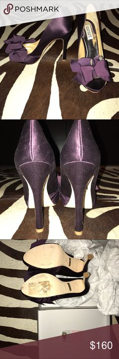 Keeper Peep-Toe Pumps in Plum Satin NIB Gorgeous plum satin Badgley Mischka Keeper pumps. Peep-toes and beautiful luscious bows. New in box, but the bottoms are a tiny bit scuffed from trying them on and there is a sticker spot on the bottom of one. Badgley Mischka Shoes Heels