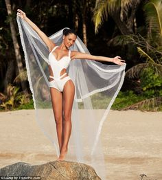 For those who aren't daring enough to say 'I do' in a one-piece, bridal swimwear is also perfect for brides who want a luxurious bikini on their tropical honeymoon